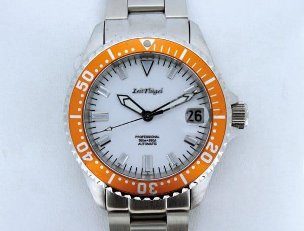 Zeitflügel Luxusuhr/ Lady Line - Exklusiv bei Juwelier Master mit orangener Lünette & weißen Ziffernblatt